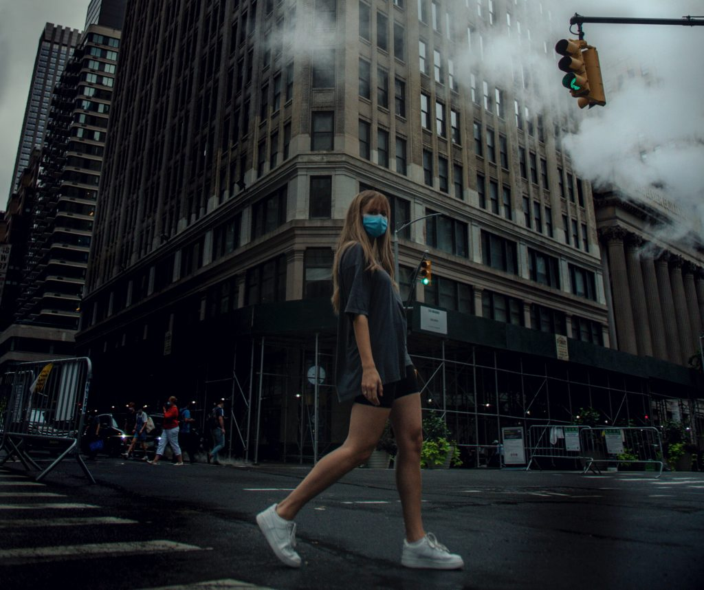 girl walking in New York city with mask on