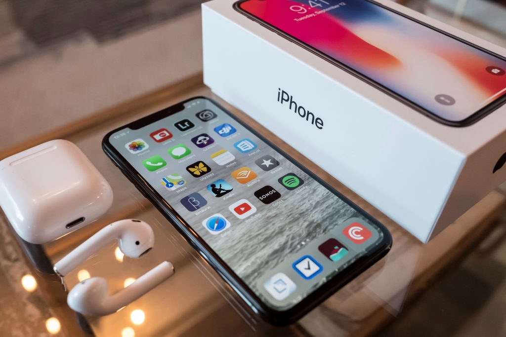 new iPhone with Apple Airpods and iPhone box