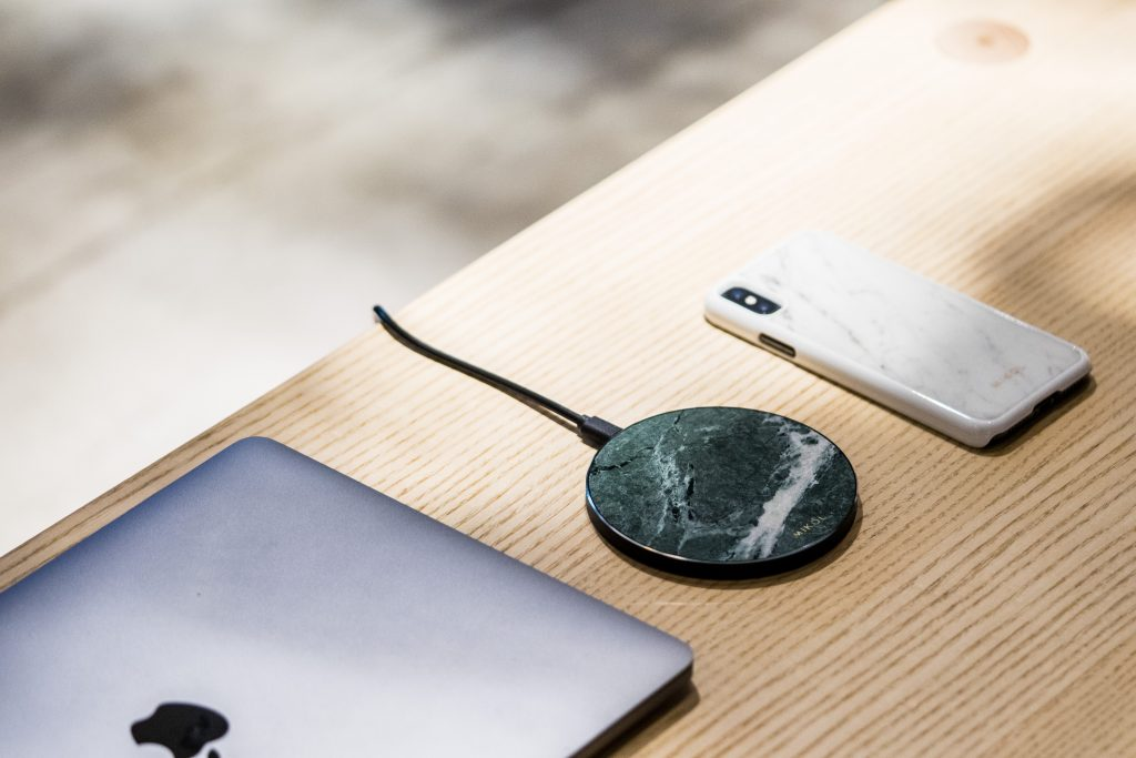 iPhone wireless charging base and macbook